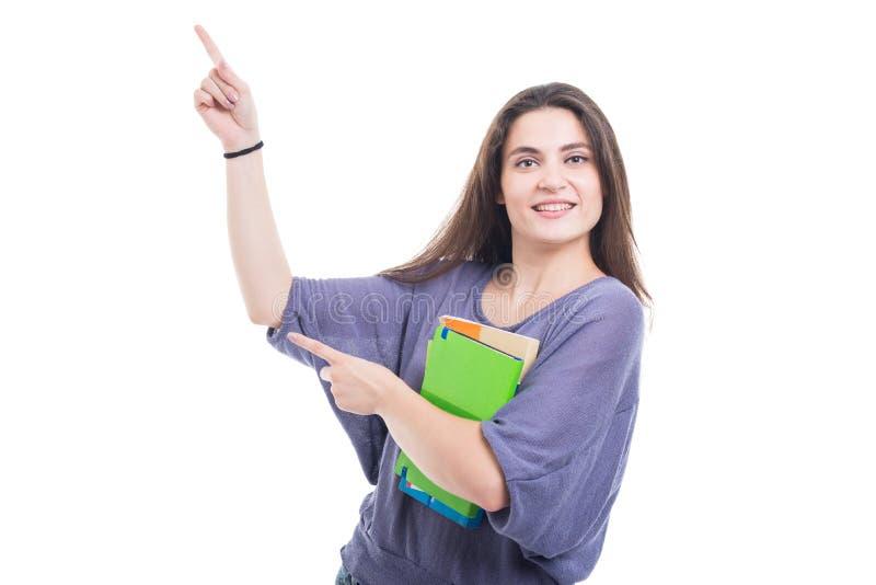 有在白色隔绝的书的年轻学生女孩 免版税库存照片