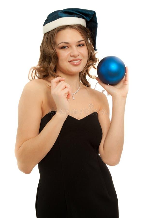 有在白色隔绝的新年球的美女 免版税库存照片