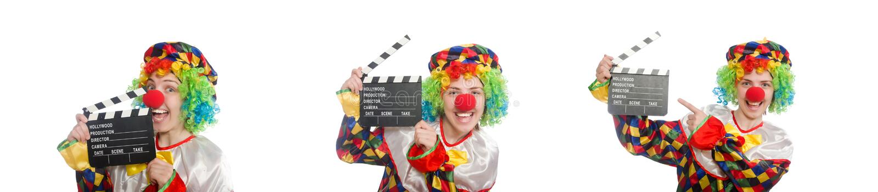 有在白色隔绝的电影拍板的小丑 免版税库存图片