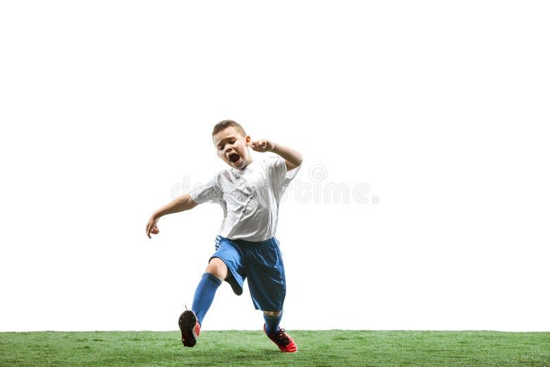 有在白色隔绝的足球的年轻男孩 足球运动员 库存图片