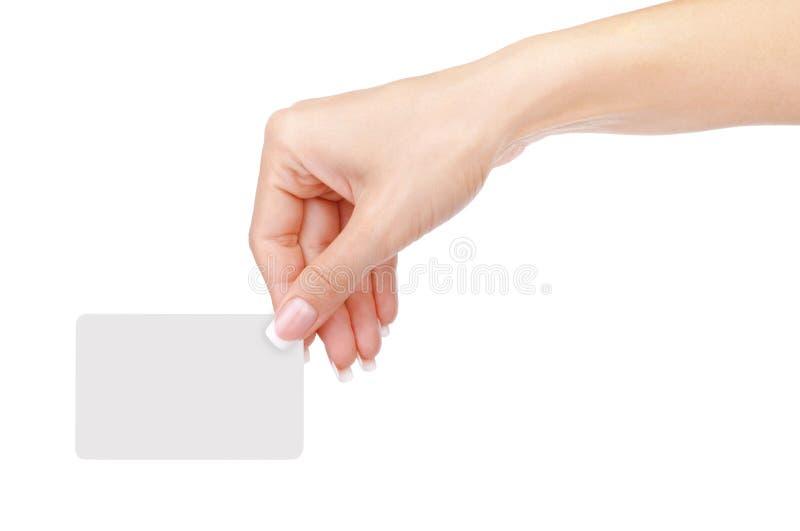 有在白色隔绝的一个空插件的女性手 图库摄影