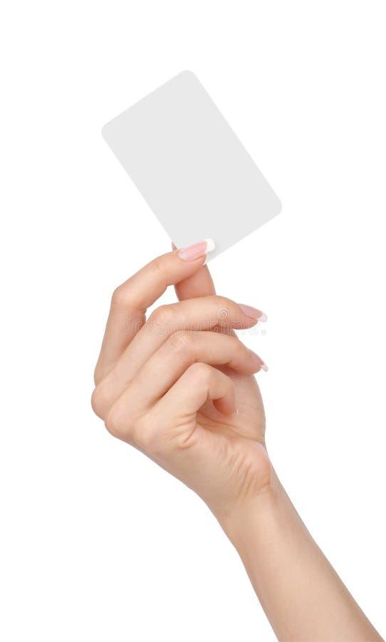 有在白色隔绝的一个空插件的女性手 免版税库存图片