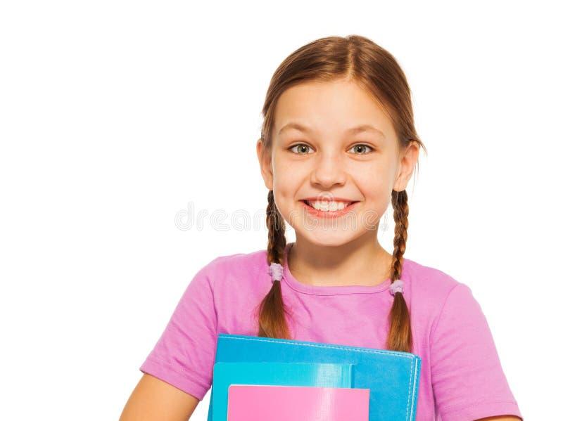 有在白色隔绝的书的愉快的正面学生 库存照片