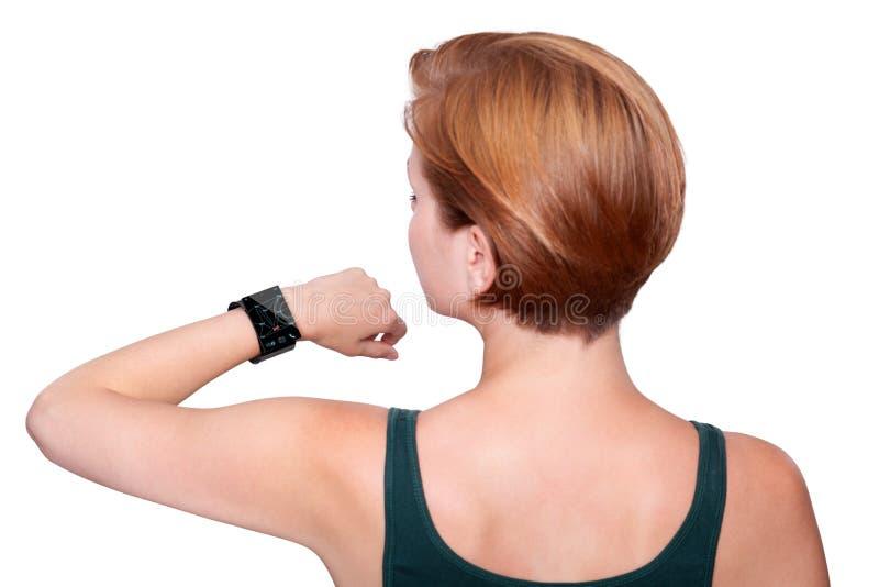 有在白色隔绝的互联网巧妙的手表的女孩 免版税库存图片