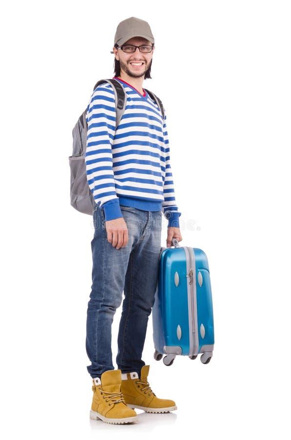 有在白色隔绝的旅行盒的年轻旅行家 免版税库存照片