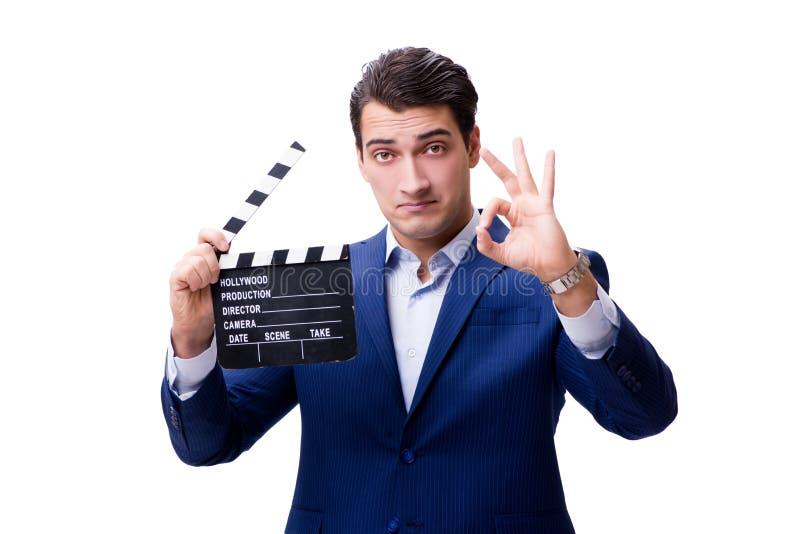 有在白色隔绝的电影拍板的英俊的人 免版税库存图片