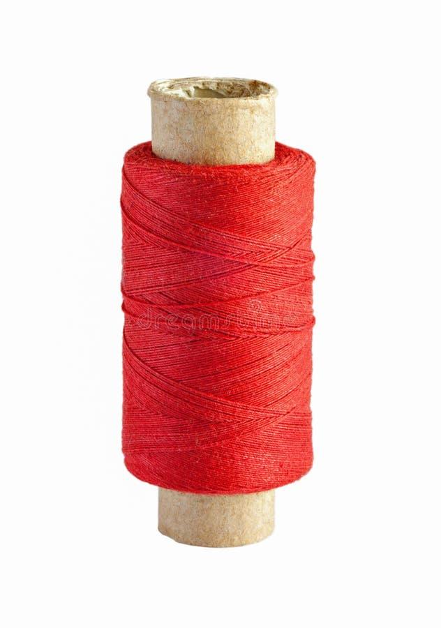 有在白色隔绝的红色螺纹的短管轴 库存图片