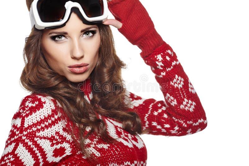 有在白色隔绝的滑雪凝视的妇女 免版税库存图片