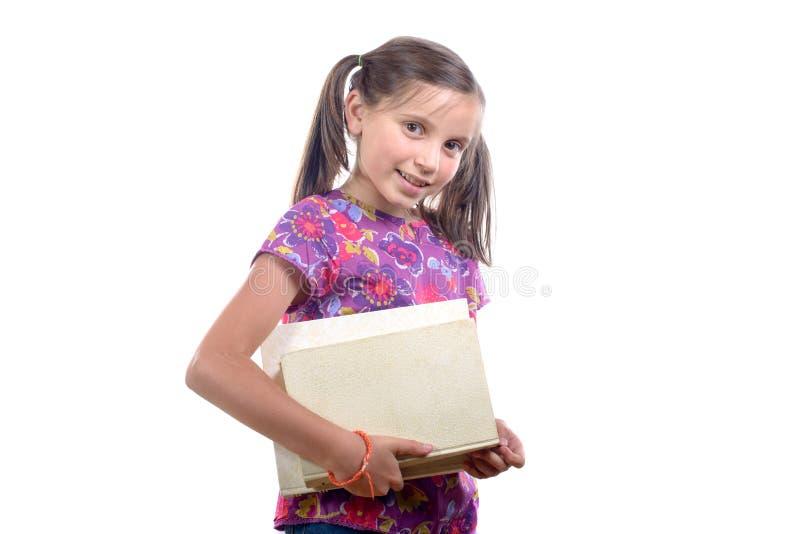 有堆的女小学生书 库存图片
