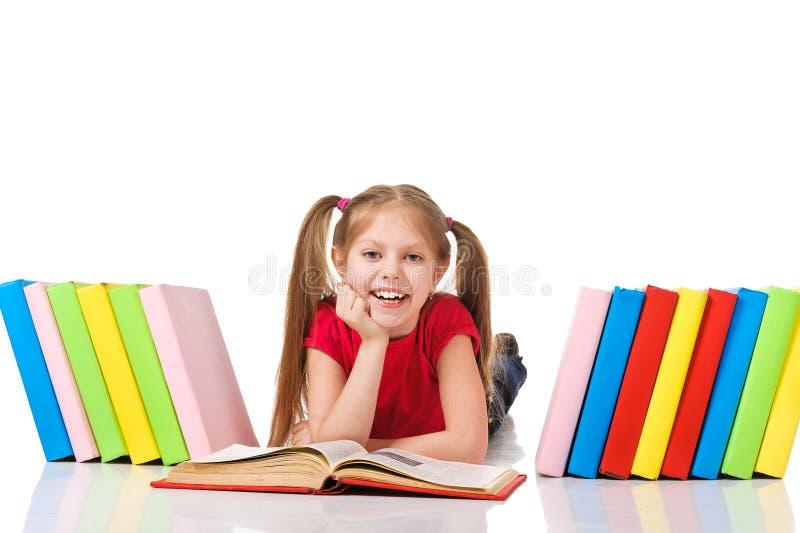 有堆的小女孩书。 图库摄影