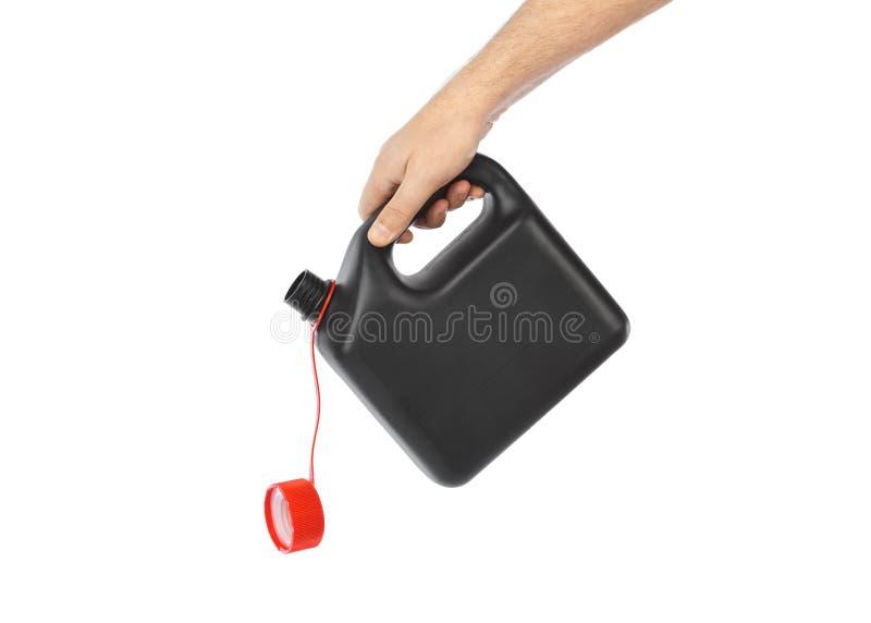有塑料五加仑装之汽油罐的手 免版税库存照片