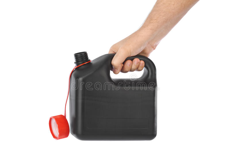 有塑料五加仑装之汽油罐的手 库存图片