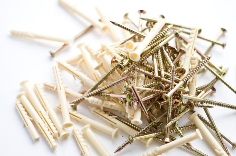 有塑料定缝销钉的螺丝 图库摄影