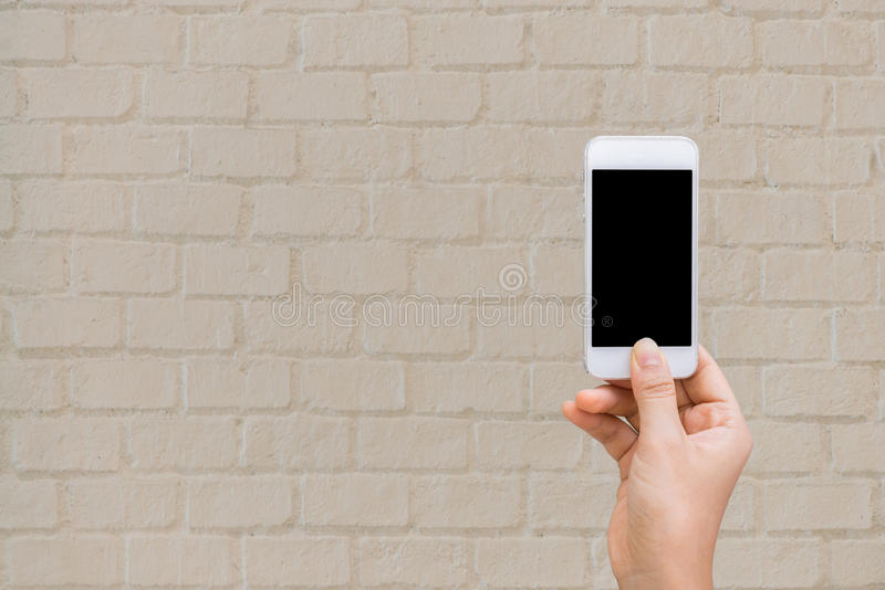 有墙壁手机的妇女手,嘲笑  免版税库存图片