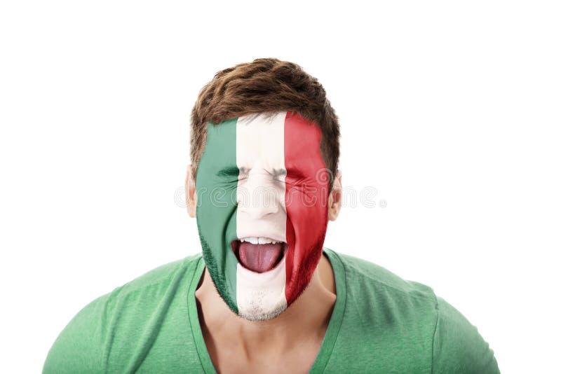 有墨西哥旗子的叫喊的人在面孔 免版税图库摄影