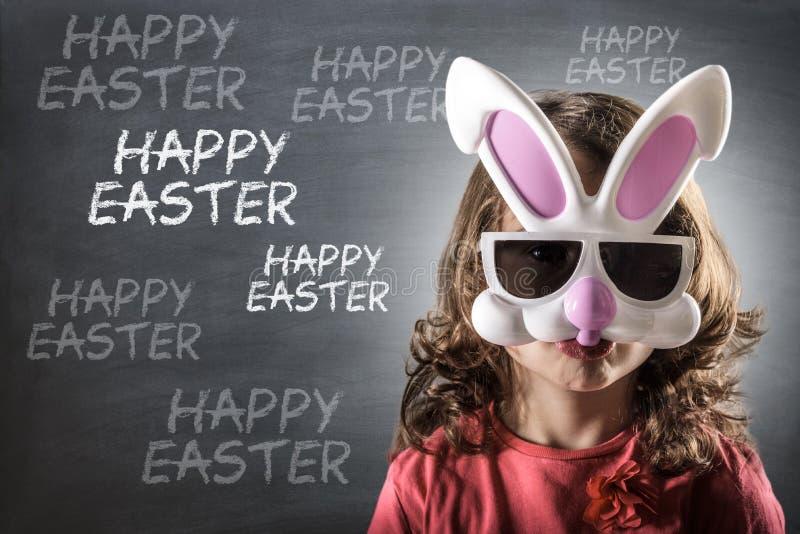 有复活节兔子面具的小女孩 库存照片