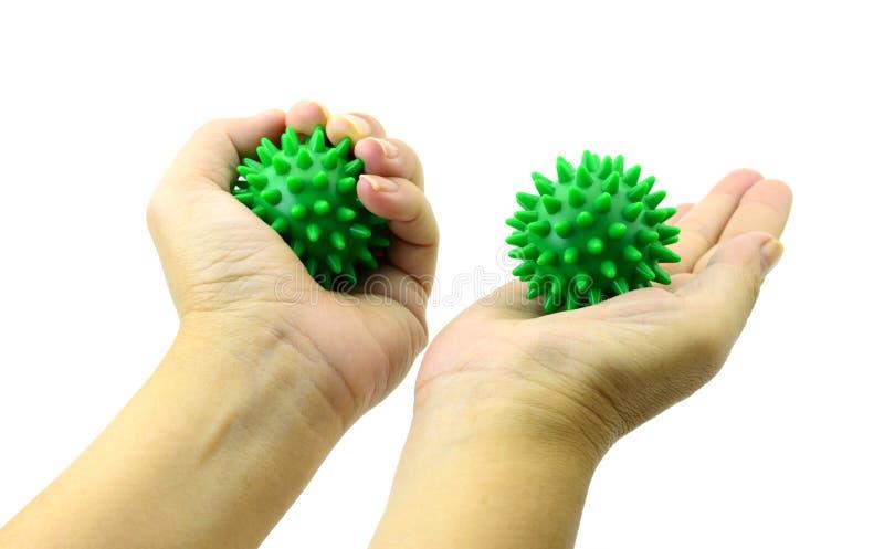 有多刺的塑料绿色按摩球孤立的手在白色 免版税库存照片