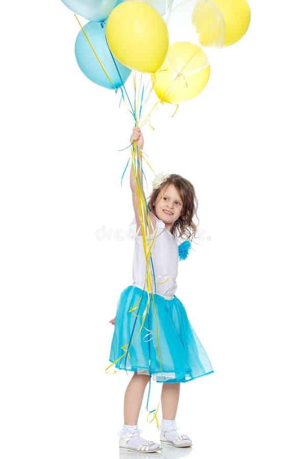 有多彩多姿的气球的小女孩 库存照片