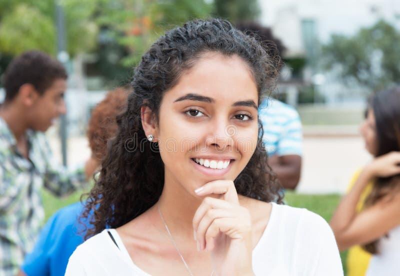 有多种族集团的笑的巴西妇女在城市 图库摄影