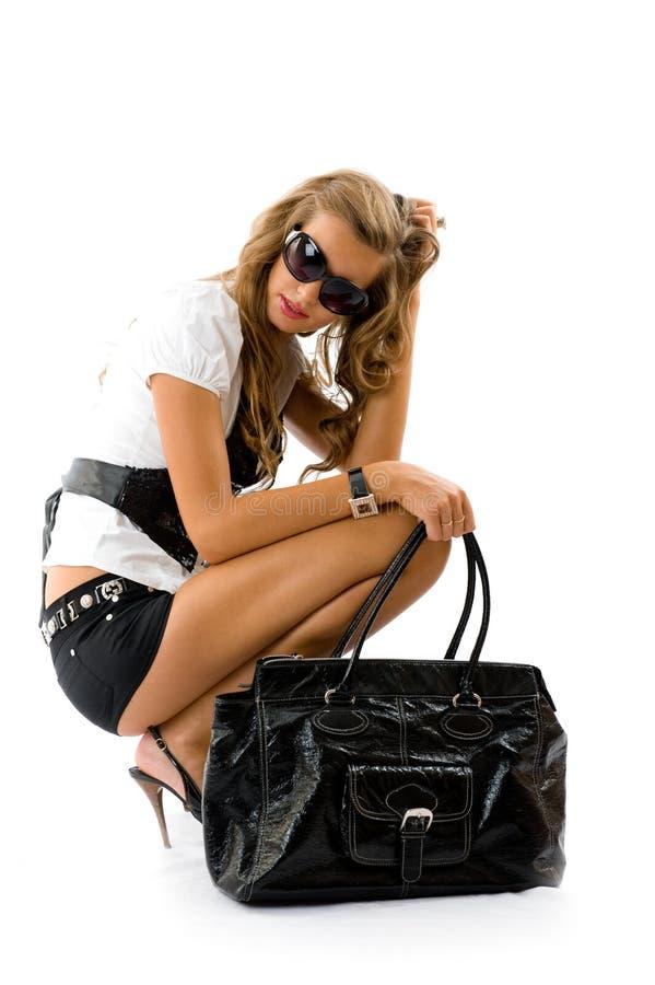 有大方式袋子的女孩 库存照片