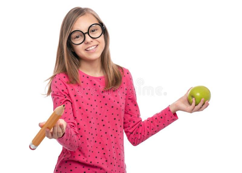 有大铅笔的青少年的女孩 免版税库存照片