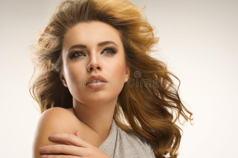 有大头发的性感的妇女 库存图片