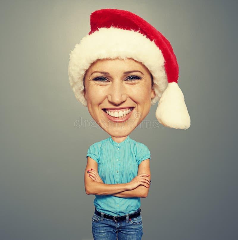 有大头的滑稽的圣诞老人女孩 免版税库存照片