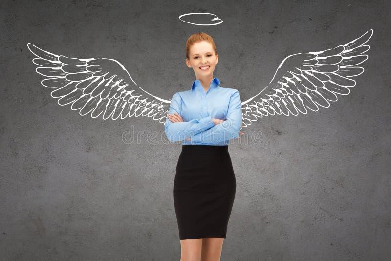 有天使翼和雨云的愉快的女实业家 免版税库存照片