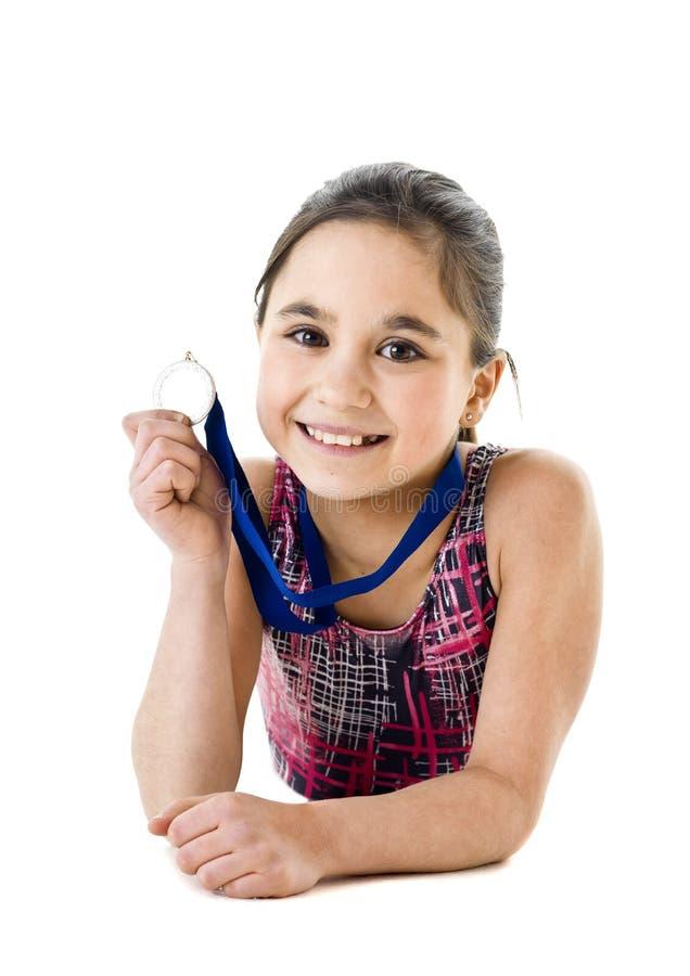 有奖牌的女孩 库存图片