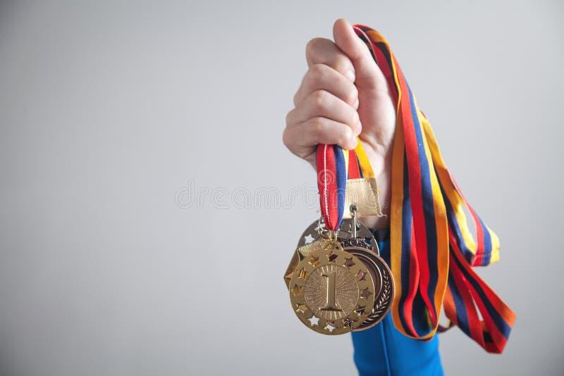 有奖牌的运动员 体育,优胜者,成功 免版税图库摄影