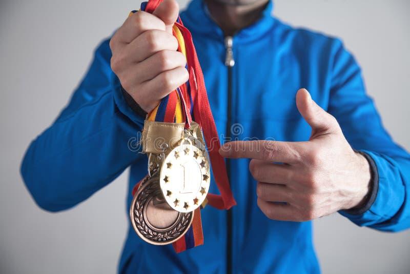 有奖牌的运动员 体育,优胜者,成功 免版税库存照片