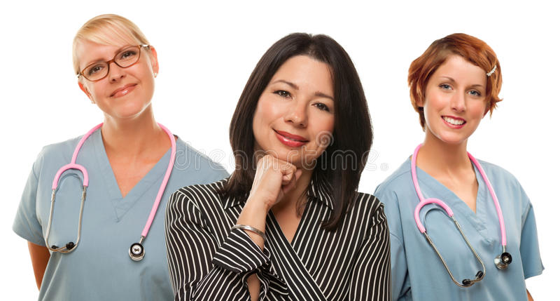 有女性医生和护士的西班牙妇女 免版税库存照片