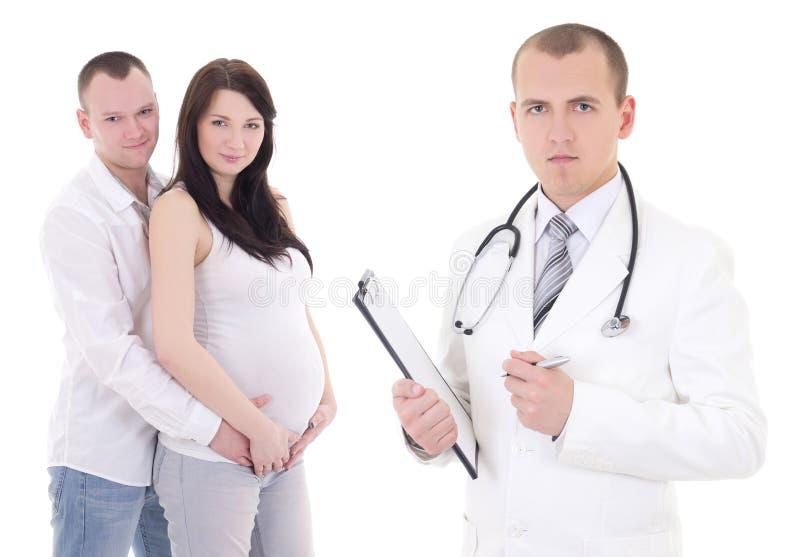 有她的丈夫和妇产科医师的年轻美丽的孕妇 免版税图库摄影