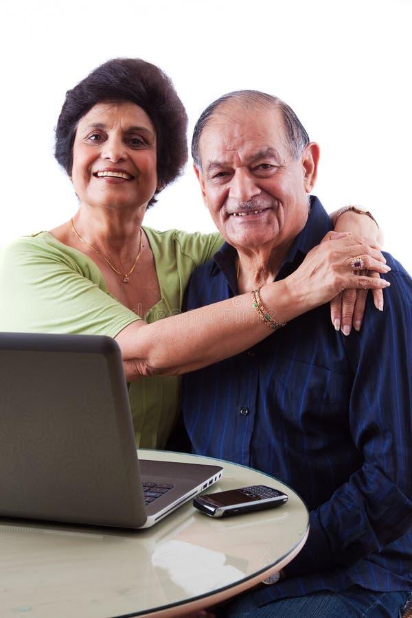 有她的丈夫的东印度人年长妇女 免版税库存照片