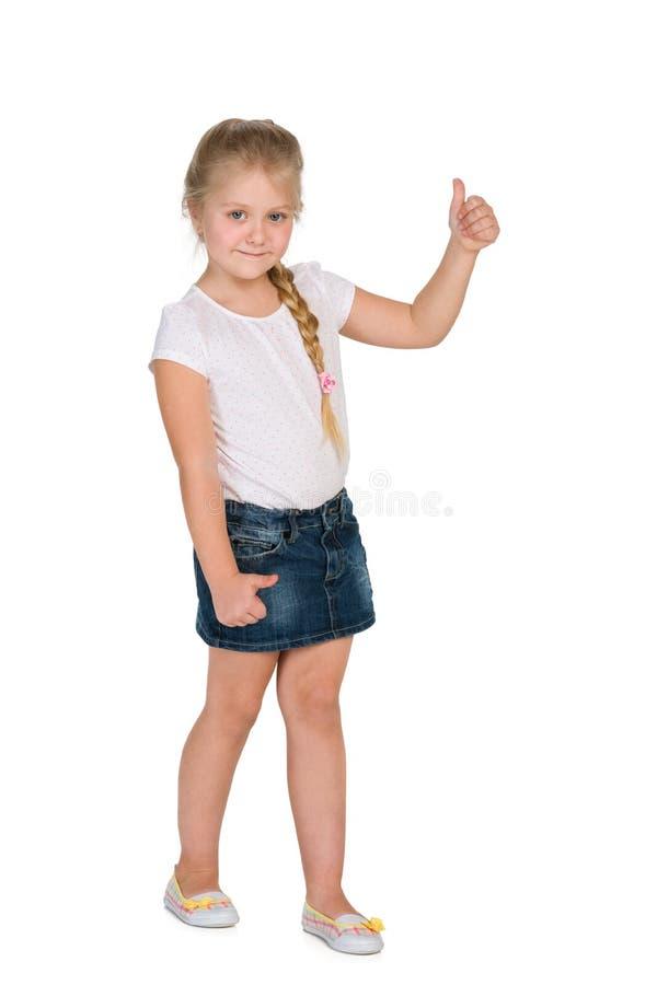 有她的赞许的小白肤金发的女孩 免版税库存图片