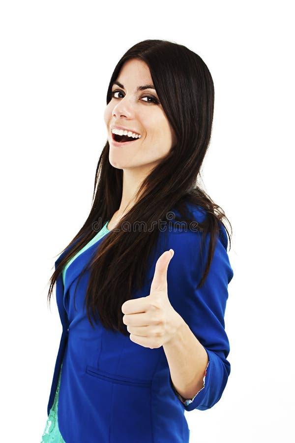 有好手标志的愉快的微笑的女商人 免版税库存图片