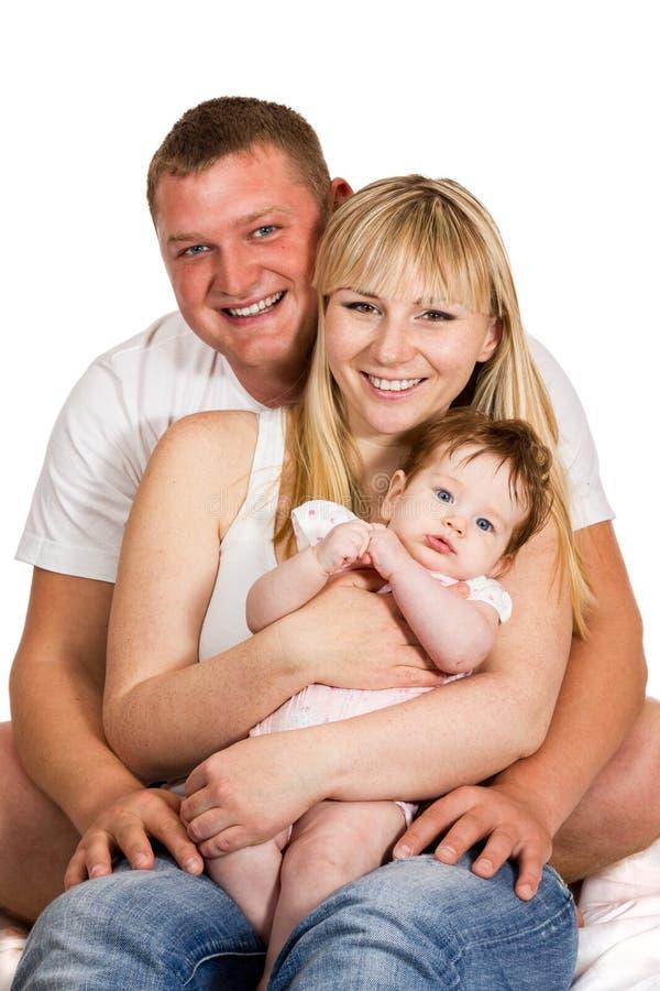有妈妈和婴孩的愉快的父亲 免版税库存图片
