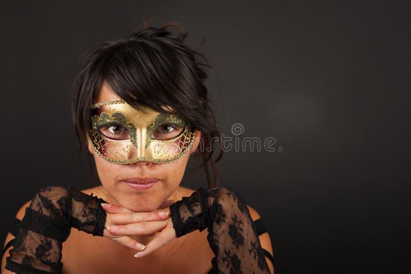有威尼斯式面具的Atractive妇女 库存图片