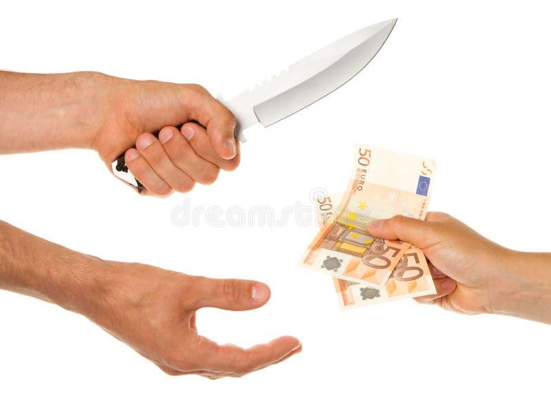 有威胁妇女的刀子的人 免版税库存图片