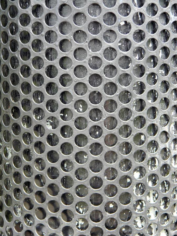 有孔的铁板材 免版税库存照片