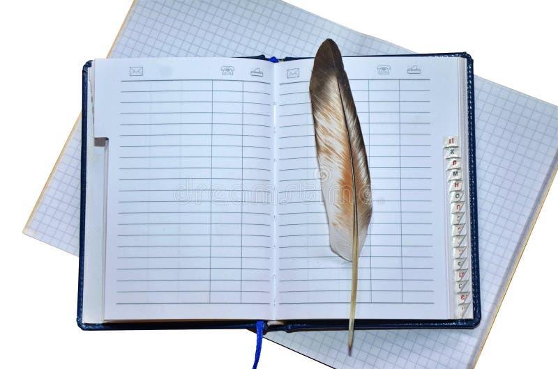 笔记本和羽毛 免版税图库摄影