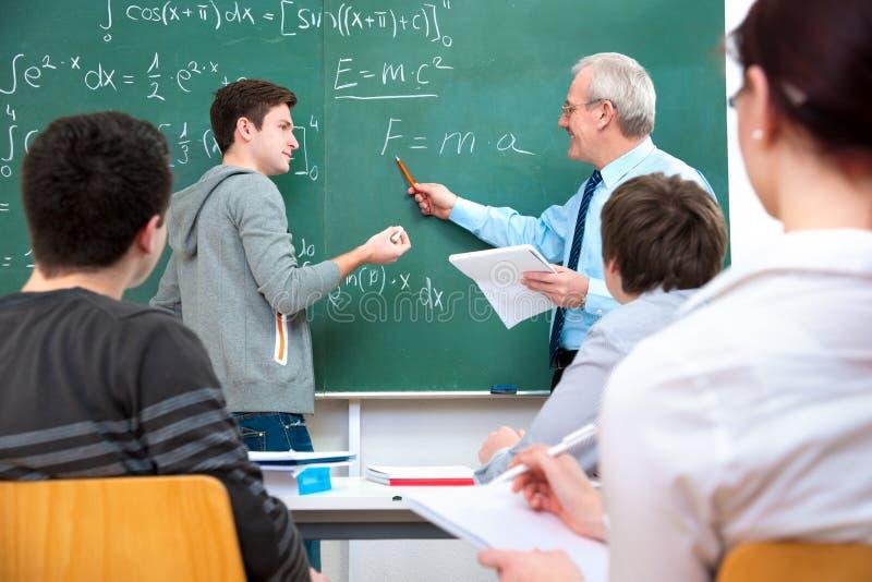 有学员的教师在教室 免版税库存图片