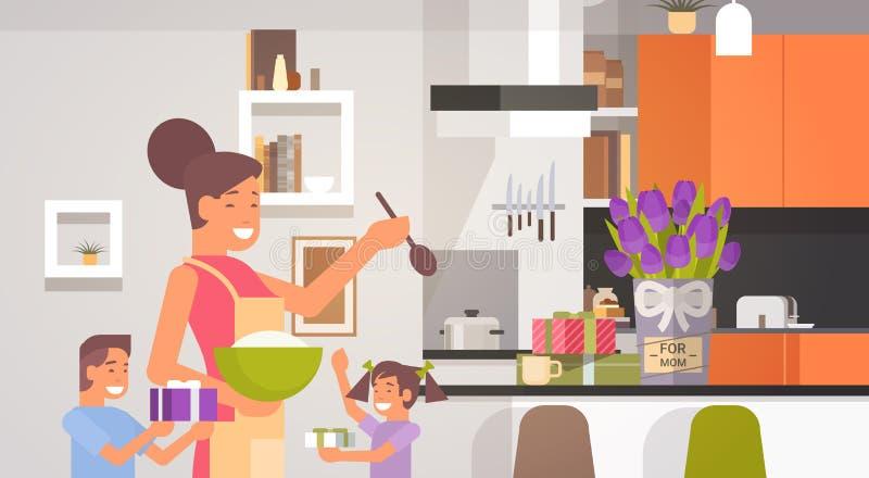 有孩子的愉快的微笑的妈妈在厨房问候母亲节,春天假日 皇族释放例证