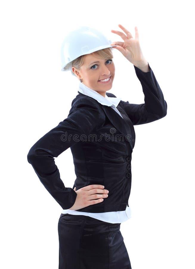 有安全帽的可爱的建筑师女孩 图库摄影