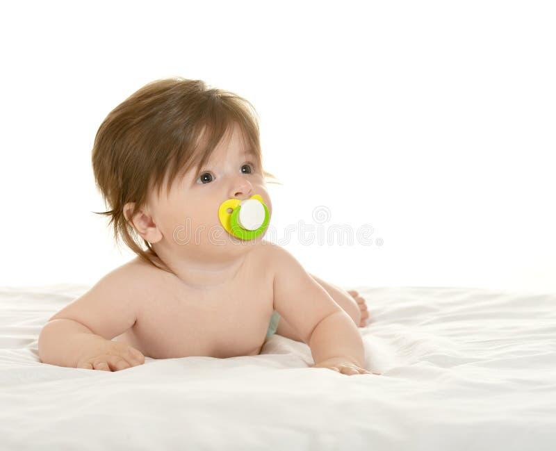 有安慰者的可爱的女婴 免版税库存图片