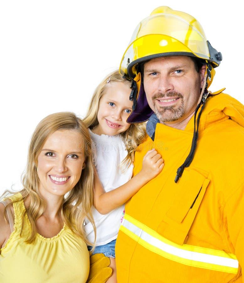 有家庭的消防员 免版税库存照片