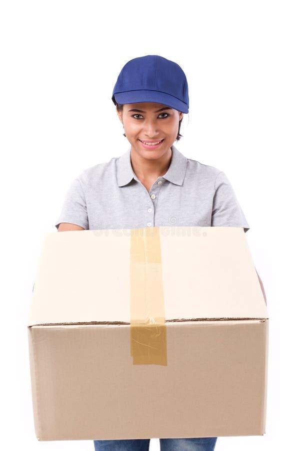 有小包的快速,愉快,女性送货业务职员或纸盒 库存照片