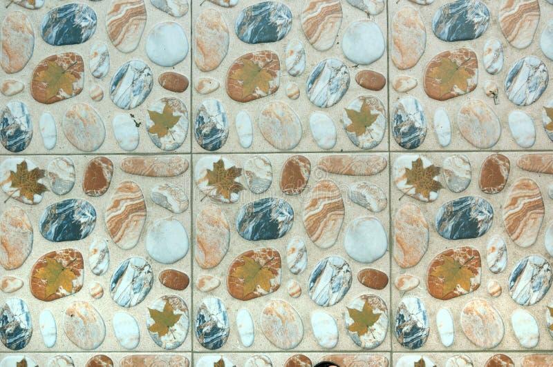 有小卵石纹理的装饰地板瓷砖 图库摄影