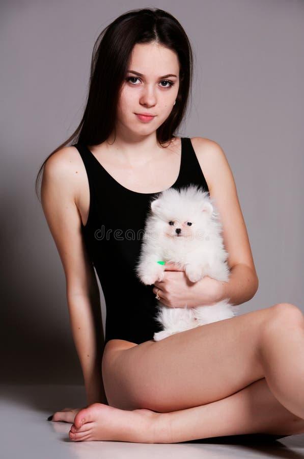有小犬座的一个女孩 库存图片