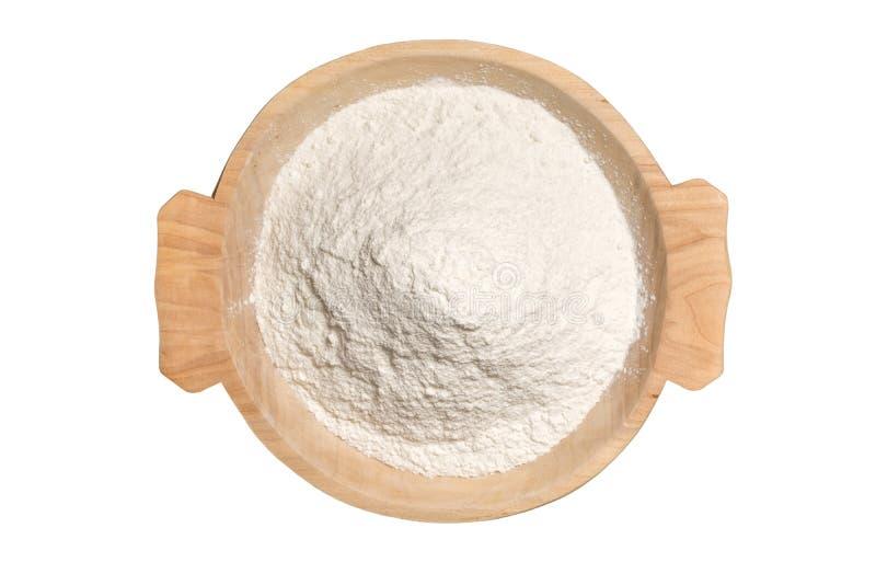 有小麦面粉粉末的木碗 库存照片